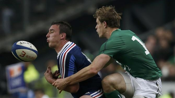 Ireland's Trimble challenges France's Chouly during their Six Nations rugby union match at the Stade de France in Saint-Denis, near Paris
