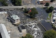 The Passaic River continues to threaten bridges and businesses Thursday, Sept. 1, 2011, in Paterson, N.J., as the effects of tropical storm Irene continue to leave areas of northern New Jersey flooded. (AP Photo/Mel Evans)