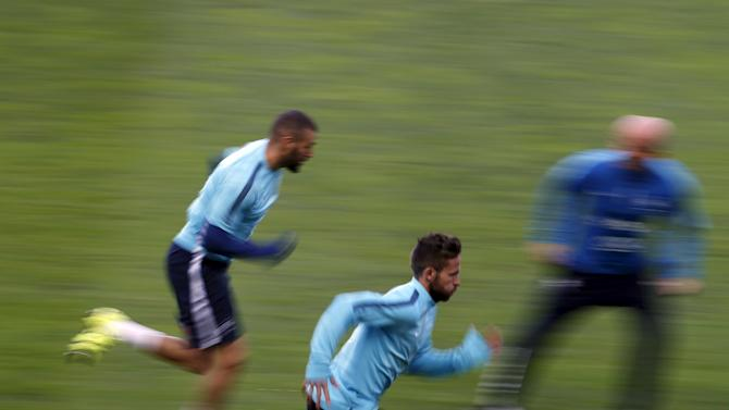 France's national soccer team players Karim Benzema and Yohan Cabaye run during a training session at Alvalade stadium in Lisbon