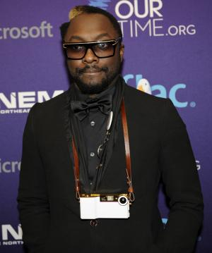 Will.i.am arrives at the OurTimes.org Inaugural Youth Ball Generation Now Party on Saturday, Jan. 19, 2013, in Washington. (Photo by Nick Wass/Invision/AP)