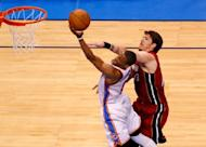 Oklahoma City Thunder's Russell Westbrook goes up for a shot next to Miami Heat's Mike Miller during the fourth quarter of the NBA Finals game one on June 12. Westbrook had 12 third-quarter points for the Thunder