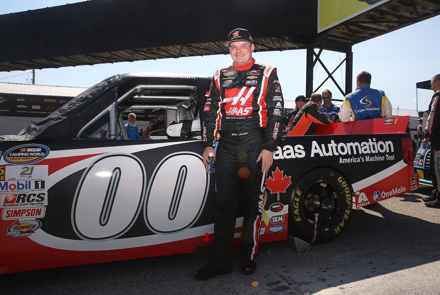 BOWMANVILLE, ON - SEPTEMBER 04: Cole Custer, driver of the #00 Haas Automation Chevrolet, poses beside his car before the start of teh race at Canadian Tire Motorsport Park on September 4, 2016 in Bowmanville, Canada. (Photo by Tom Szczerbowski/NASCAR/NASCAR via Getty Images)