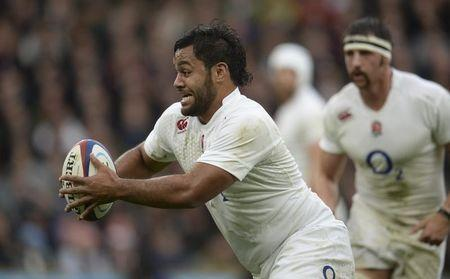 England's Vunipola makes a break during their international rugby union match against South Africa at Twickenham in London