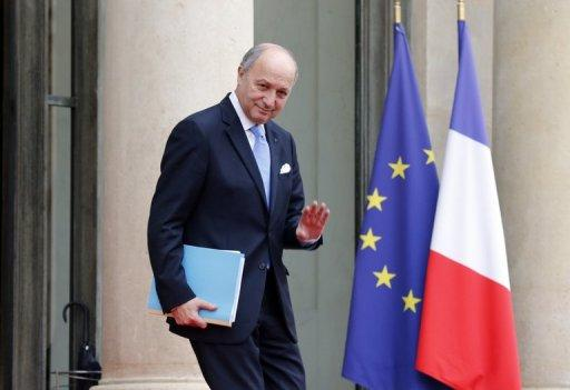 French minister of foreign affairs Laurent Fabius gestures as he leaves the Elysee presidential Palace after attending the weekly cabinet meeting on November 21. France has allocated 1.2 million euros ($1.5 million) in emergency aid to the newly formed opposition Syrian National Coalition, Foreign Minister Laurent Fabius said on Monday