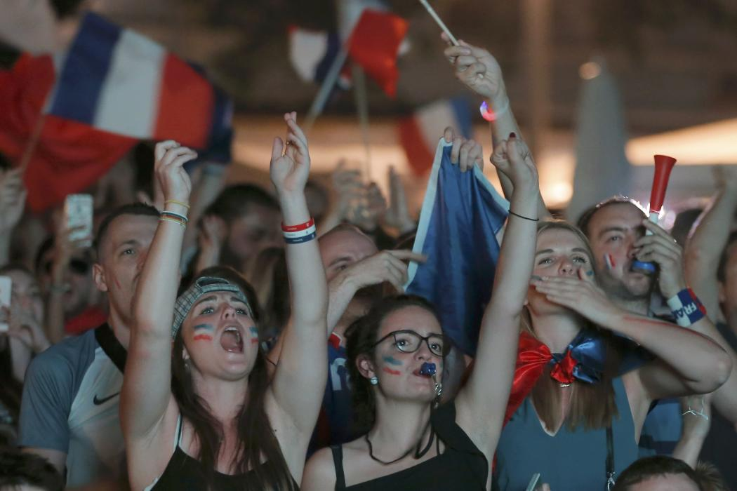 France fans react in a fan zone during a EURO 2016 semi final soccer match