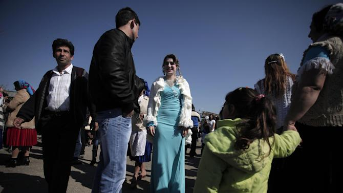 "This Saturday, March 23, 2013  photo shows Roma bride-to-be from the Kalaidzhi community during so called ""Roma bridal market"" . The Kalaidzhi, who represent only a small portion of the estimated 700,000 Roma in Bulgaria, are almost all devout Orthodox Christians who keep teenage boys and girls separate. Parents sometimes remove girls from school at 15 or even earlier to keep them from mixing with boys. The isolation is broken only by Internet chats and the twice-a-year bridal fairs.  (AP Photo/Valentina Petrova)"