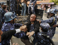 Nepal police detain Tibetans who were shouting anti-China slogans in tribute to the Tibetans who died in the recent self-immolation, in Katmandu, Nepal, Tuesday, Nov. 1, 2011. Nepal police detained more than 100 Tibetans exiles who were protesting against the Chinese rule over their homeland. (AP Photo/Binod Joshi)