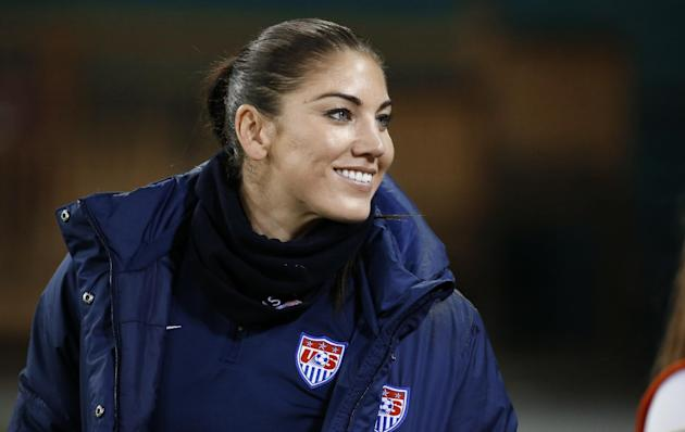 In this Oct. 20, 2014, file photo, U.S. goalkeeper Hope Solo stands on the sidelines before a CONCACAF soccer match against Haiti in Washington. Solo had domestic violence assault charges against her