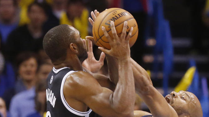 Oklahoma City Thunder guard Derek Fisher (6) fouls Brooklyn Nets guard Alan Anderson (6) as he shoots during the fourth quarter of an NBA basketball game in Oklahoma City, Thursday, Jan. 2, 2014. Oklahoma City won 95-93. (AP Photo/Sue Ogrocki)