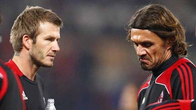 David Beckham (L) and Paolo Maldini (Reuters)