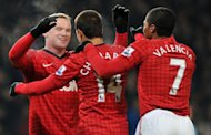 Manchester United striker Wayne Rooney (L) celebrates scoring the only goal in the FA Cup third-round replay win over West Ham at Old Trafford on January 16, 2013. But the England man wasted a chance to put the result beyond doubt when he blazed over a penalty 12 minutes from time