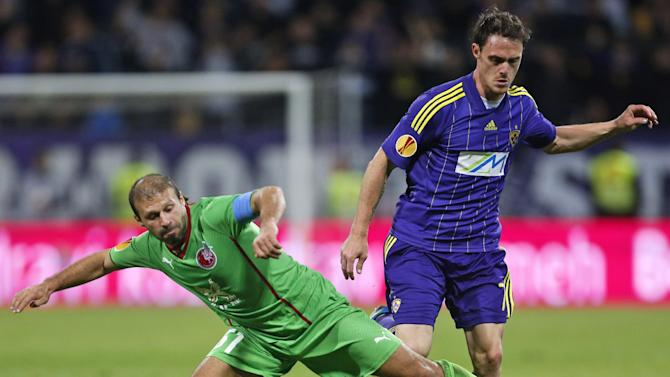 Rubin Kazan's Gokdeniz Karadeniz, left, is challenged by Maribor's Ales Mejac during their group D Europa League soccer match, in Maribor, Slovenia, Thursday, Sept. 19, 2013