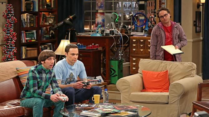 "This undated publicity image released by CBS shows, from left, Simon Helberg, Jim Parsons, and Johnny Galecki in a scene from ""The Big Bang Theory,"" a long-running series, one of 18 shows renewed by CBS on Wednesday, March 27, 2013. (AP Photo/CBS, Michael Yarish)"