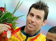 FILE PHOTO - Grant Hackett of Australia holds his silver medal for the men's 1500m freestyle swimming final at the National Aquatics Center during the Beijing 2008 Olympic Games, August 17, 2008. REUTERS/Kai Pfaffenbach/File Photo