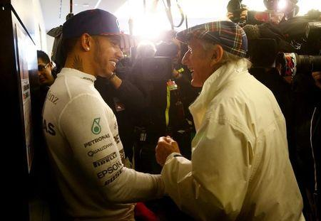 Mercedes Formula One driver Hamilton of Britain chats with three time retired world champion Stewart of Britain after Hamilton won the U.S. F1 Grand Prix at the Circuit of The Americas in Austin
