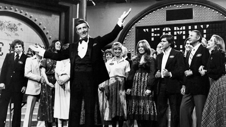 "FILE - In this May 8, 1978 file photo, Richard Dawson, foreground, is in his familiar role as host of ""Family Feud"" when the casts of ABC's comedy series ""Eight is Enough,"" ""The Love Boat,"" ""Soap,"" and ""Three's Company"" compete to benefit charity. Dawson, the wisecracking British entertainer who was among the schemers in the 1960s sitcom ""Hogan's Heroes"" and a decade later began kissing thousands of female contestants as host of the game show ""Family Feud"" died Saturday, June 2, 2012. He was 79. (AP Photo, File)"