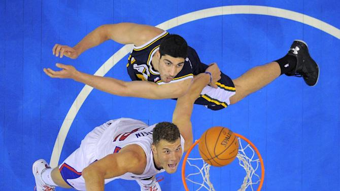 Los Angeles Clippers forward Blake Griffin, below, puts up a shot as Utah Jazz center Enes Kanter, of Turkey, defends during the second half of an NBA basketball game, Saturday, Feb. 1, 2014, in Los Angeles