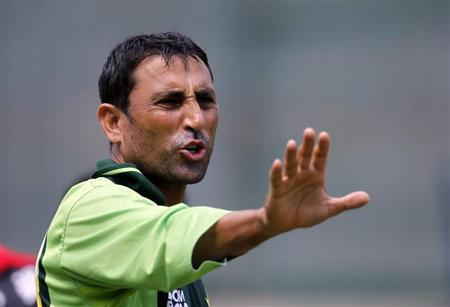 Pakistan's Younus Khan gestures during a practice session ahead of their ICC Cricket World Cup semi-final match against India in Mohali