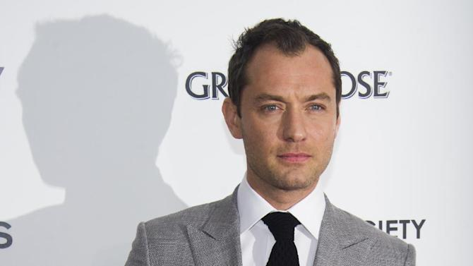 "Jude Law attends the premiere of ""Side Effects"" hosted by the Cinema Society and Open Road Films on Thursday, Jan. 31, 2013 in New York. (Photo by Charles Sykes/Invision/AP)"