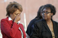 Louvon Harris, left, covers her face as Clara Taylor, right, both sisters of James Byrd Jr., looks back while answering a question after witnessing the execution of Lawrence Russell Brewer Wednesday, Sept. 21, 2011, in Huntsville, Texas. Brewer, 44, one of two purported white supremacists condemned for the dragging death of James Byrd Jr., was executed Wednesday. Brewer was convicted for his participation in chaining Byrd to the back of a pickup truck, dragging the black man along a rural East Texas road and dumping what was left of his shredded body outside a black church cemetery in 1998. (AP Photo/David J. Phillip)