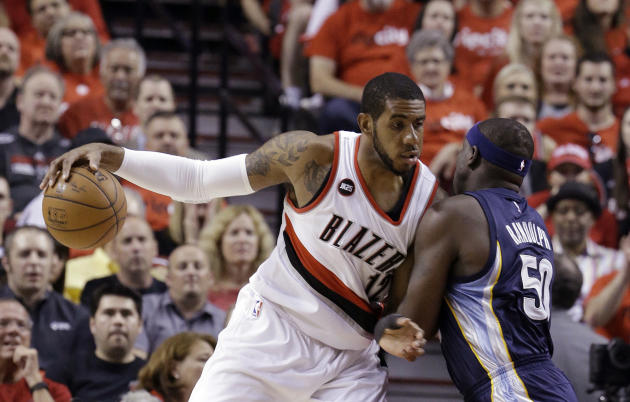 FILE - In this Monday, April 27, 2015 file photo, Portland Trail Blazers forward LaMarcus Aldridge, left, works the ball in against Memphis Grizzlies forward Zach Randolph during the first half of Gam