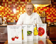 "FILE - In this March 23, 2011 file photo, Nathan Myhrvold, author of ""Modernist Cuisine: The Art and Science of Cooking,"" as he poses with five books from the work at the Institute for Culinary Education in New York. On Friday, May 4, 2012, Myhrvold won a James Beard Award for Cookbook of the Year. (AP Photo/Stephen Chernin, File)"