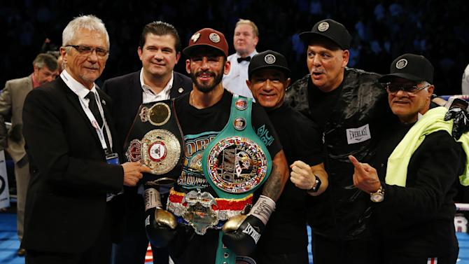 Jorge Linares celebrates with his team after winning the fight