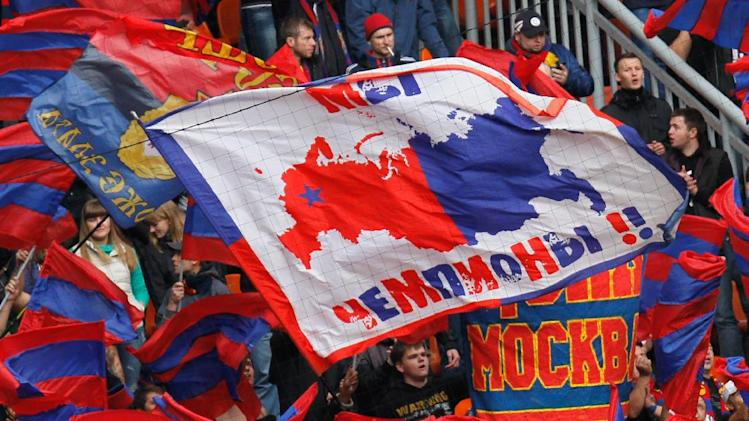 "CSKA Moscow's fans wave their symbols and banner reading ""We are champions!"" during a Russian Premier League Championship soccer match between CSKA Moscow and Spartak Moscow at the Lokomotiv stadium in Moscow, Russia, Sunday, Sept. 22, 2013. Spartak won 3-0"