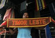 An East Timorese vendor displays a cloth at a traditional market in Dili. Former military commander Taur Matan Ruak was ahead in an early count for East Timor's presidential run-off vote on Monday, according to the elections secretariat
