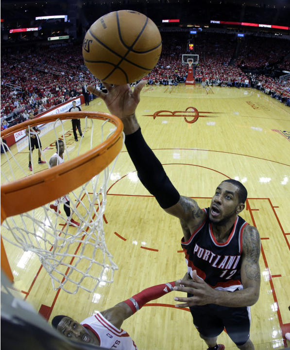 Portland Trail Blazers' LaMarcus Aldridge (12) goes up for a shot against the Houston Rockets during the second half in Game 1 of an opening-round NBA basketball playoff series Sunday, April 20, 2