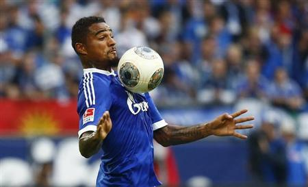 Kevin Prince Boateng, new striker for Schalke 04, controls the ball during their German first division Bundesliga soccer match against Bayer Leverkusen in Gelsenkirchen, August 31, 2013. REUTERS/Kai Pfaffenbach
