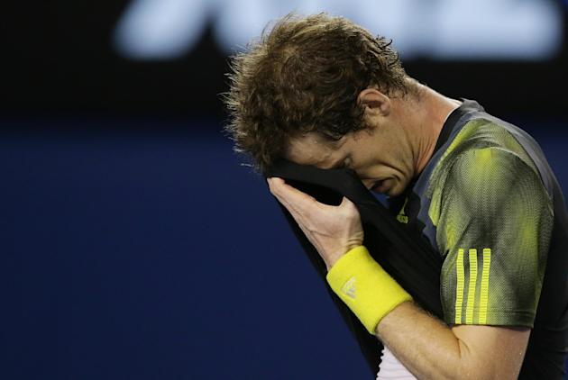 Britain's Andy Murray wipes the sweat from his face during the men's final against Serbia's Novak Djokovic at the Australian Open tennis championship in Melbourne, Australia, Sunday, Jan. 27, 2013. (A