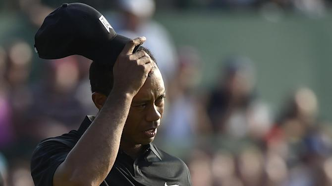 Golf - Tiger Woods's triple bogey leaves him tied for last