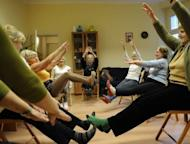 Ludwika Kochman (in yellow leotard) leads a a gym session in Poznan, Poland. A dozen seniors in Poznan do gymnastics every Monday, guided by Kochman in a class run by an international group focused on helping the elderly stay young, on March 5