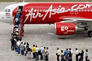Malaysian low-cost airline Air Asia is in talks with Belgrade to buy the Serbian national airline JAT