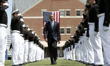 U.S. President Barack Obama walks through an honor cordon as the arrives for the 134th Commencement Exercises of the United States Coast Guard Academy in New London, Connecticut May 20, 2015. REUTERS/Kevin Lamarque