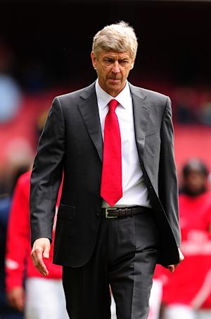 Arsene Wenger, pictured, accepts that 'life goes on' following Robin van Persie's move to Old Trafford