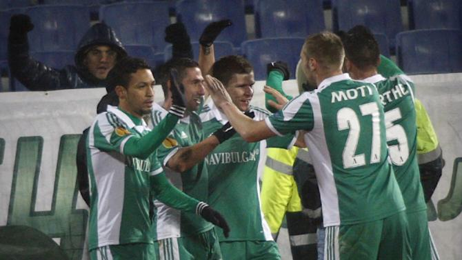 Ludogorets'  team celebrate their goal against PSV Eindhoven  during a Europa League group B soccer match between Ludogorets and PSV Eindhoven at the Vassil Levski Stadium in Sofia, Bulgaria, Thursday, Nov. 28, 2013. (AP Photo)