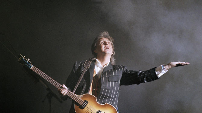 "FILE - In this Wednesday June 3, 1993 file photo, Paul McCartney performs before a crowd of about 50,000 as a steady drizzle falls during his ""New World Tour"" concert stop St. County Stadium in Milwaukee. McCartney turned 70 years of age Monday June 18, 2012.  (AP Photo/Chris Corsmeier, File)"