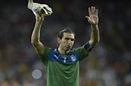 Italian goalkeeper Gianluigi Buffon reacts after the Euro 2012 football championships final match Spain vs Italy on July 1, 2012 at the Olympic Stadium in Kiev. AFP PHOTO / FILIPPO MONTEFORTE