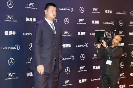 Former NBA basketball player Yao Ming arrives for the Laureus World Sports Awards 2015 in Shanghai