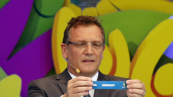 "FIFA Secretary General Jerome Valcke holds the slip showing ""Germany"" during the draw for the 2014 World Cup at the Costa do Sauipe resort in Sao Joao da Mata"
