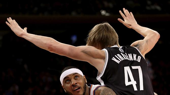 New York Knicks' Carmelo Anthony, left, looks for the basket past Brooklyn Nets' Andrei Kirilenko during the first half of the NBA basketball game at Madison Square Garden Monday, Jan. 20, 2014, in New York
