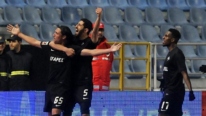 Academica's Fernando Alexandre, left, celebrates with Rafik Halliche, from Algeria, after scoring the opening goal against FC Porto in a Portuguese League soccer match at the Municipal Stadium in Coimbra, Portugal, Saturday, Nov. 30, 2013