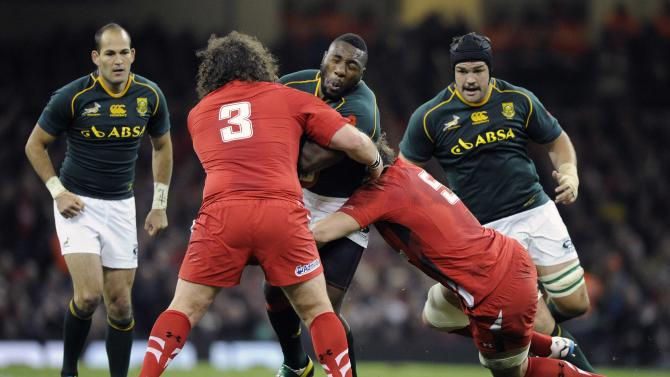 Wales' Adam Jones tackles South Africa's Tendai Mtawarira during the international rugby union match at the Millennium Stadium in Cardiff
