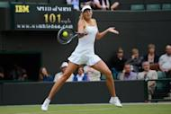 Maria Sharapova plays a forehand shot during her match against Tsvetana Pironkova on Thursday. Sharapova was forced to dig deep before securing her place in the Wimbledon third round with a 7-6 (7/3), 6-7 (3/7), 6-0 victory