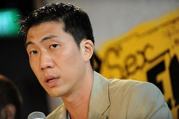 """Local film director Ken Kwek speaking at a press conference last year with regard to his debut film, """"Sex.Violence.FamilyValues"""", that was initially banned in October. (AFP file photo)"""