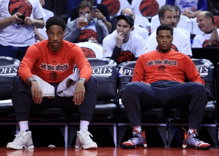 DeMar DeRozan and Kyle Lowry zone out. (Vaughn Ridley/ Getty Images)