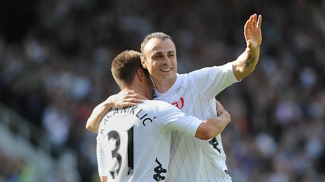 Dimitar Berbatov, right, scored a first-half brace on his Fulham home debut