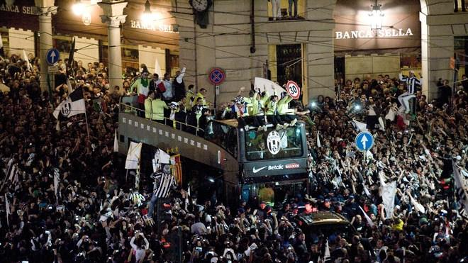 The Bus Of Juventus Football Team Parades On The Crowded Piazza Castello Of Turin To Celebrate Their Italian Serie A AFP/Getty Images